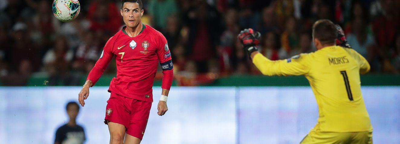 Portugal`s Cristiano Ronaldo (L) scores a goal against Luxembourg during the UEFA 2020 Qualifying round - Group B soccer match of Portugal  and Luxembourg at Alvalade  stadium in Lisbon, Portugal, 11 October 2019.  MARIO CRUZ/LUSA