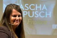 """Former Austrian kidnap victim Natascha Kampusch poses during the presentation of her book """"10 Jahre Freiheit"""" (""""10 Years Freedom"""") marking the 10th anniversary of her escape from her captor Wolfgang Priklopil on August 17, 2016, in Vienna. / AFP PHOTO / APA / HERBERT PFARRHOFER / Austria OUT"""