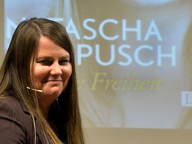 "Former Austrian kidnap victim Natascha Kampusch poses during the presentation of her book ""10 Jahre Freiheit"" (""10 Years Freedom"") marking the 10th anniversary of her escape from her captor Wolfgang Priklopil on August 17, 2016, in Vienna. / AFP PHOTO / APA / HERBERT PFARRHOFER / Austria OUT"
