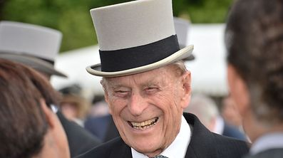 This file photo taken on June 01, 2017 shows Britain's Prince Philip, Duke of Edinburgh greets guests at a garden party at Buckingham Palace in London on June 1, 2017.