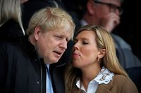 """(FILES) In this file photo taken on March 07, 2020 Britain's Prime Minister Boris Johnson (L) with his partner Carrie Symonds attend the Six Nations international rugby union match between England and Wales at the Twickenham, west London. - British Prime Minister Boris Johnson's partner Carrie Symonds on April 29, 2020 gave birth to a """"healthy baby boy"""" in a London hospital, a spokesman for the couple said. """"Both mother and baby are doing very well,"""" the spokesman said in a surprise announcement, as Symonds was not thought to be due until later in the year. (Photo by ADRIAN DENNIS / AFP)"""