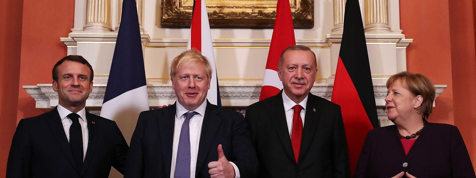 Emmanuel Macron, Boris Johnson, Recep Tayyip Erdogan et Angela Merkel (de g. à dr.)