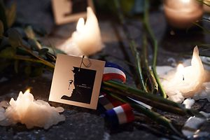 """Candles are lit on a pop-up memorial for the victims of Paris' attacks on November 14, 2015 at Marseille Vieux Port, southern France. A total of 129 people died and 352 were injured in the attacks in Paris in what for now is only """"a temporary"""" toll, the Paris prosecutor said.AFP PHOTO / ANNE-CHRISTINE POUJOULAT"""