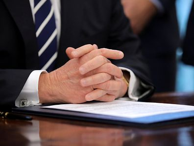 The hands of U.S. President Donald Trump