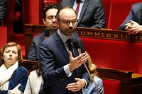 French Prime Minister Edouard Philippe speaks during a session of questions to the government at the French National Assembly in Paris on March 27, 2018. / AFP PHOTO / FRANCOIS GUILLOT