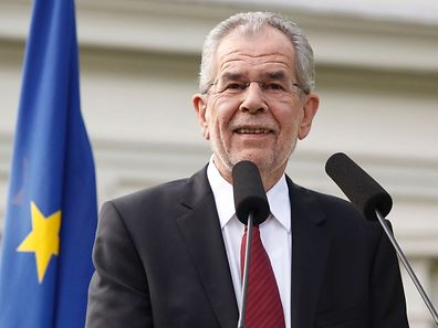 The green candidate for Austrian Presidency Alexander Van der Bellen addresses a Press conference after wining the election in Vienna, Austria on May 23, 2016. The Austrian government confirmed that green-backed candidate Alexander van der Bellen narrowly beat his far-right rival Norbert Hofer to the presidency after postal votes broke a tie in the closely watched race. / AFP PHOTO / Dieter Nagl