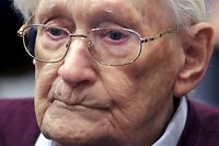 """Oskar Groening, defendant and former Nazi SS officer dubbed the """"bookkeeper of Auschwitz"""", is pictured in the courtroom during his trial in Lueneburg, Germany, July 15, 2015. The 94-year-old German man who worked as a bookkeeper at the Auschwitz death camp was convicted on Wednesday of being an accessory to the murder of 300,000 people and was sentenced to four years in prison, in what could be one of the last big Holocaust trials. REUTERS/Axel Heimken/Pool"""
