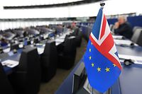 """This picture taken on October 22, 2019, shows a half English and half European flag during a debate on the last EU summit and Brexit at the European Parliament in Strasbourg, eastern France. - European Commission President Jean-Claude Juncker said that the EU had done """"all in our power"""" to ensure an orderly Brexit, but said the bloc would await British parliamentary approval for a new divorce deal before ratifying it. Juncker who started his tenure as EU President in 2014, will step down from his position on October 31, 2019. (Photo by FREDERICK FLORIN / AFP)"""