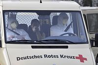 A van of the German Red Cross (DRK) carrying German citizens repatriated from the chinese city affected by the corona virus, Wuhan arrives at the German Red Cross (DRK) hospital in Berlin Kopenick, on February 9, 2020. - A plane of the German Air Force with twenty Germans from the Chinese city of Wuhan, which is particularly affected by the corona virus, landed in Berlin-Tegel on February 9, 2020. (Photo by John MACDOUGALL / AFP)