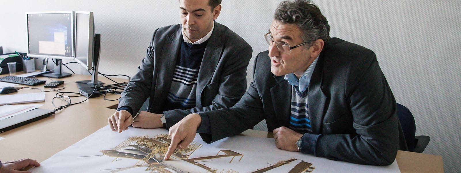 Bob Greiveldinger und Tom Roster (rechts): Die Herstellung von passenden Docks muss genau geplant werden.