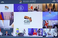 Japanese Prime Minister Yoshihide Suga (top L), US President Donald Trump (top R), South Korean President Moon Jae-in (down L), and European Commission President Ursula von der Leyen (down C) are seen on a screen before the start of a virtual G20 summit hosted by Saudi Arabia and held over video conference amid the Covid-19 (novel coronavirus) pandemic, in Brussels, on November 21, 2020. - Saudi Arabia hosts a G20 summit on November 21 and 22, in a first for an Arab nation, with the virtual forum dominated by efforts to tackle the coronavirus pandemic and the worst global recession in decades. (Photo by YVES HERMAN / POOL / AFP)
