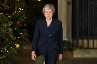 Britain's Prime Minister Theresa May arrives to make a statement outside 10 Downing Street in central London after winning a confidence vote on December 12, 2018. (Photo by Oli SCARFF / AFP)