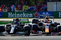 Mercedes' British driver Lewis Hamilton (L) and Red Bull's Dutch driver Max Verstappen collide during the Italian Formula One Grand Prix at the Autodromo Nazionale circuit in Monza, on September 12, 2021. (Photo by ANDREJ ISAKOVIC / AFP)