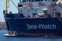 An image grab taken from a video released by Local Team on June 26, 2019, shows the Sea-Watch 3 NGO boat heading towards the Lampedusa island, on the Mediterranean Sea. - The Sea-Watch 3 NGO boat carrying migrants rescued in the Mediterranean is headed for Lampedusa island despite the threat of hefty fines from Italy's far-right interior minister. (Photo by - / LOCALTEAM / AFP) / Italy OUT
