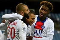 Paris Saint-Germain's French forward Kylian Mbappe (C) celebrates after scoring a goal with Paris Saint-Germain's French defender Layvin Kurzawa (L) and PAris Saint-Germain's French defender Timothee Pembele during the French L1 football match between Montpellier Herault (MHSC) and Paris Saint Germain (PSG) at the Mosson Stadium in Montpellier, southern France, on December 05, 2020. (Photo by Pascal GUYOT / AFP)