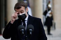 French President Emmanuel Macron scratches his eye as he addresses the press upon the arrival of Portuguese Prime minister for a working lunch at the Elysee presidential palace in Paris on December 16, 2020. (Photo by Thomas COEX / AFP)
