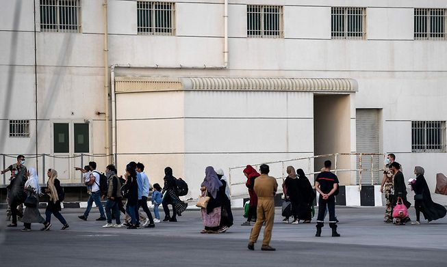 People disembark from a military transport aircraft near Abu Dhabi