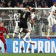 Ajax's Dutch defender Matthijs de Ligt (C) jumps to score his team's second goal past Juventus' Polish goalkeeper Wojciech Szczesny (L) during the UEFA Champions League quarter-final second leg football match Juventus vs Ajax Amsterdam on April 16, 2019 at the Juventus stadium in Turin. (Photo by Isabella BONOTTO / AFP)