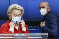European Commission President Ursula Von Der Leyen (L) and European Council President Charles Michel, wearing face masks, arrive to give a press briefing at the end of a European Council meeting mainly focused on the Covid-19 crisis in Brussels on October 29, 2020. - More and more European countries are adopting drastic measures to curb the spread of the outbreak as part of accelerating efforts worldwide to check a resurgent coronavirus. (Photo by Olivier HOSLET / POOL / AFP)