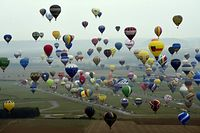 """A picture taken on July 28, 2017 shows an aerial view of hot air-balloons at Chambley-Bussieres airbase, near Hageville, eastern France, before the world record attempt of the biggest line with 456 balloons on July 28, 2017 as part of the biennal event """"Mondial Air Ballons"""", an international air-balloon meeting. / AFP PHOTO / POOL / Alexandre MARCHI"""