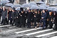 (FromL) President of the European Commission Jean-Claude Juncker, Lithuania's President Dalia Grybauskaite, Denmark's Prime Minister Lars Lokke Rasmussen, Morocco's Prince Moulay Hassan, Moroccan King Mohammed VI, German Chancellor Angela Merkel, French President Emmanuel Macron and his wife Brigitte Macron, Canadian Prime Minister Justin Trudeau, Turkish President's wife Emine Erdogan and Niger's President's Lalla Malika Issoufou arrive at the Arc de Triomphe in Paris on November 11, 2018 to attend a ceremony as part of commemorations marking the 100th anniversary of the 11 November 1918 armistice, ending World War I. (Photo by Eric FEFERBERG / AFP)