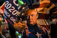 TOPSHOT - A Trump supporter wears a t-shirt depicting the US president as Captain America during a protest in Miami, Florida on November 5, 2020. - Democratic presidential challenger Joe Biden on Thursday edged toward the magic number of 270 electoral votes needed to win the White House, but several battleground states were still in play, as incumbent President Donald Trump cried foul over the ongoing vote count. (Photo by CHANDAN KHANNA / AFP)