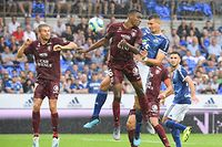 Strasbourg's French forward Ludovic Ajorque (R) vies with Metz' Malian midfielder Mamadou Fofana (C) and Metz' French defender Thomas Delaine (L) during the French L1 football match between Strasbourg (RCSA) and Metz (FCM) at the Meinau stadium in Strasbourg, eastern France, on August 11, 2019. (Photo by PATRICK HERTZOG / AFP)
