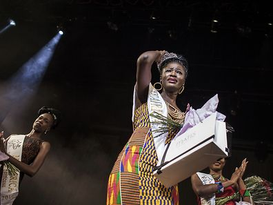 Miss Ghana, Rebecca Asamoah (C), reacts as she is crowned the first ever Miss Africa on April 30, 2016 in Johannesburg, South Africa.  Barefoot, wearing traditional costumes including animal hide skirts and elaborately beaded headdresses, the contestants strutted the stage before Ghanaian Rebecca Asamoah was crowned the first Miss Africa Continent.  / AFP PHOTO / JOHN WESSELS