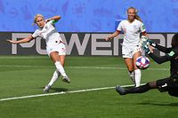 TOPSHOT - England's defender Steph Houghton (L) scores a goal during the France 2019 Women's World Cup round of sixteen football match between England and Cameroon, on June 23, 2019, at the Hainaut stadium in Valenciennes, northern France. (Photo by Denis Charlet / AFP)
