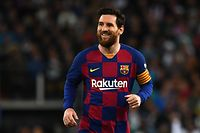 """(FILES) In this file photo taken on March 01, 2020, Barcelona's Argentine forward Lionel Messi smiles during the Spanish League football match between Real Madrid and Barcelona at the Santiago Bernabeu stadium in Madrid. - Lionel Messi said on September 4, 2020 that he will stay at Barcelona, insisting he could never go to court against """"the club of his life"""". (Photo by GABRIEL BOUYS / AFP)"""