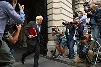 Britain's Prime Minister Boris Johnson returns to Downing Street following a cabinet meeting at the Foreign and Commonwealth office on September 15, 2020. (Photo by DANIEL LEAL-OLIVAS / AFP)