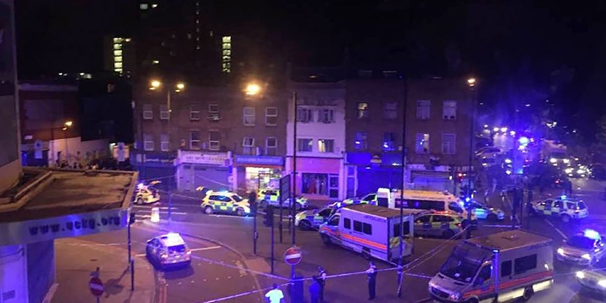 This general view shows police vehicles at the scene early on June 19, 2017, after a vehicle hit pedestrians in north London.