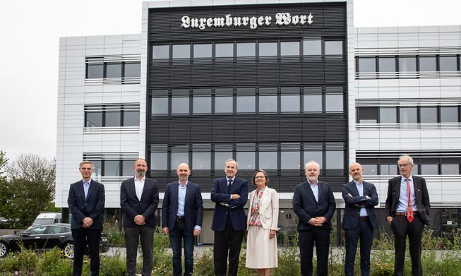 The board of directors of Mediahuis Luxembourg outside the new offices in Howald