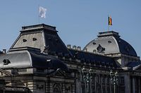 A white flag in flies in the wind atop the Royal Palace in Brussels on March 23, 2020, during a national lockdown in Belgium to curb the spread of COVID-19 (novel coronavirus). (Photo by THIERRY ROGE / BELGA / AFP) / Belgium OUT