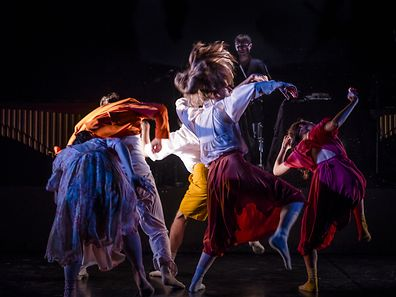 The piece begins with four dancers mirroring each other's movements.