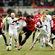 FC Zorya Luhansk's Jaba Lipartia (L) and Dmytro Grechyshkin (R) vie with Manchester United FC's Paul Pogba (C) during the UEFA Europa League football match between FC Zorya Luhansk and Manchester United FC at the Chornomorets stadium in Odessa on December 8, 2016. / AFP PHOTO / SERGEI SUPINSKY