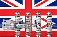(FILES) This file illustration photo taken on November 17, 2020 shows vials with Covid-19 Vaccine stickers attached, and syringes, with a national flag of the United Kingdom, the Union flag. Drugs company AstraZeneca and British Prime Minister Boris Johnson on January 28, 2021 defended the effectiveness of its Covid-19 vaccine after regulators in Germany said it should not be given to over 65s. (Photo by JUSTIN TALLIS / AFP)