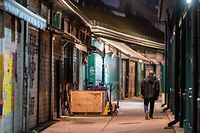 A man walks past closed market stalls at the Naschmarkt in Vienna on November 2, 2020, a few hours before a second lockdown during the ongoing novel coronavirus (Covid-19) pandemic. - Austria's government announced on October 31 a second mass shutdown and a curfew starting next week until the end of November, in an attempt to halt rocketing coronavirus infection numbers. (Photo by GEORG HOCHMUTH / APA / AFP) / Austria OUT