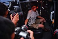Pro-democracy activist Joshua Wong leaves the Eastern Magistrates� Courts after being released on bail in Hong Kong on August 30, 2019. - Prominent democracy activists including a lawmaker were arrested on August 30 in a dragnet across Hong Kong -- a move described by rights groups as a well-worn tactic deployed by China to suffocate dissent ahead of key political events. (Photo by Lillian SUWANRUMPHA / AFP)