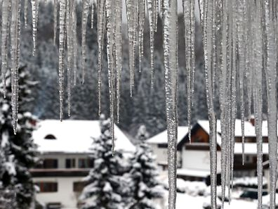 Icycles hang at a house in Oberstdorf, southern Germany, on January 8, 2017.
