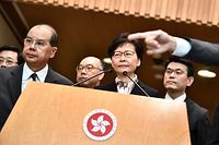 "Hong Kong Chief Executive Carrie Lam (C) listens to a question during a press conference in Hong Kong on August 5, 2019. - Hong Kong's embattled pro-Beijing leader accused pro-democracy protesters of trying to ""destroy"" the financial hub in a dramatic escalation of rhetoric as the financial hub is rocked by two months of rallies and clashes. (Photo by Anthony WALLACE / AFP)"