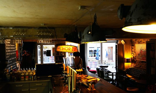 Antique spotlights and cinema seats create cosy atmosphere at this Vianden cafe
