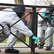 """(FILES) In this file photo taken on March 16, 2018 Personel take photographs as they swab railings near a bench covered in a protective tent at The Maltings shopping centre in Salisbury, southern England, on March 16, 2018, as investigations and operations continue in connection with the major incident sparked after a man and a woman were apparently poisoned in a nerve agent attack in Salisbury on March 4. The world's chemical arms watchdog on April 12, 2018 confirmed Britain's findings that a nerve agent used in an attack on former spy Sergei Skripal and his daughter Yulia in England last month originally came from Russia. Blood samples tested by the Organisation for the Prohibition of Chemical Weapons (OPCW) """"confirm the findings of the United Kingdom relating to the identity of the toxic chemical,"""" according to a summary of the Hague-based group's report released in London.  / AFP PHOTO / Ben STANSALL"""