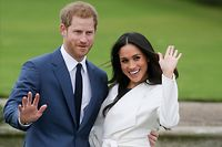 """(FILES) In this file photo taken on November 27, 2017 Britain's Prince Harry and his fianc�e US actress Meghan Markle pose for a photograph in the Sunken Garden at Kensington Palace in west London following the announcement of their engagement. - Meghan Markle has been """"saddened"""" by reports published on Wednesday, March 3 that she faced a bullying complaint during her time at Kensington Palace and before she stepped back from royal duties, her spokesman said. (Photo by Daniel LEAL-OLIVAS / AFP)"""