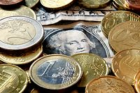 Euro coins and dollar bills are seen in Frankfurt, central Germany, Wednesday, Feb. 27, 2008. The euro soared higher on Wednesday, Feb. 27, 2008, climbing to a high of US$1.5057 in early European trading as sentiment that the U.S. Federal Reserve would continue its rate cut campaign intensified when its chairman testifies before the U.S. Congress. (AP Photo/Michael Probst)