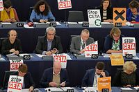 """Members of the Confederal Group of the European United Left of the European Parliament display posters with the words """"stop CETA"""" as they take part in a voting session at the European Parliament in Strasbourg, France, October 26, 2016. REUTERS/Vincent Kessler"""