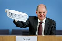 German Finance Minister Olaf Scholz speaks during a joint press conference on the supplemental budget 2020 amid the novel coronavirus pandemic on March 23, 2020 in Berlin. - German ministers agreed to blast through a constitutional limit on government deficits with 156 billion euros of new borrowing to fight the impact of the novel coronavirus, Finance Minister Olaf Scholz said. (Photo by Michael Sohn / POOL / AFP)
