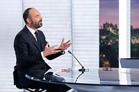 French Prime Minister Edouard Philippe gestures prior to delivering a speech on the government's pensions overhaul, on the set of French TV channel France 2, in Paris on January 12, 2020. - A crippling French transport strike dragged into its 39th day on January 12, 2020 despite the government's offer to withdraw the most contested measure of the pension reform plans that sparked the protest. Prime Minister Edouard Philippe said on January 11 he would drop plans to increase the official retirement age to 64 from 62 in an effort to end a strike which has paralysed Paris and its suburbs, with bus, train and metro services all badly disrupted. (Photo by GEOFFROY VAN DER HASSELT / AFP)