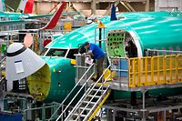 (FILES) In this file photo taken on March 27, 2019 Employees work on Boeing 737 MAX airplanes at the Boeing Renton Factory in Renton, Washington. - US regulators said on June 26, 2019 that Boeing must address new issues on the 737 Max airplane. (Photo by Jason Redmond / AFP)