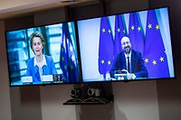 European Council President Charles Michel (R) and European Commission President Ursula von der Leyen are sen on screen as they hold a videoconference  prior to EU-UK talks via videoconference, at the European Council building in Brussels on June 15, 2020. - EU chiefs held a videoconference with the British prime minister on June 15 to breathe new life into stalled post-Brexit trade talks, with both sides entrenched in long-held positions. Expectations are low for the long-planned meeting, with all sides agreeing last week that trade negotiations would be intensified over the coming months. (Photo by Francisco Seco / POOL / AFP)